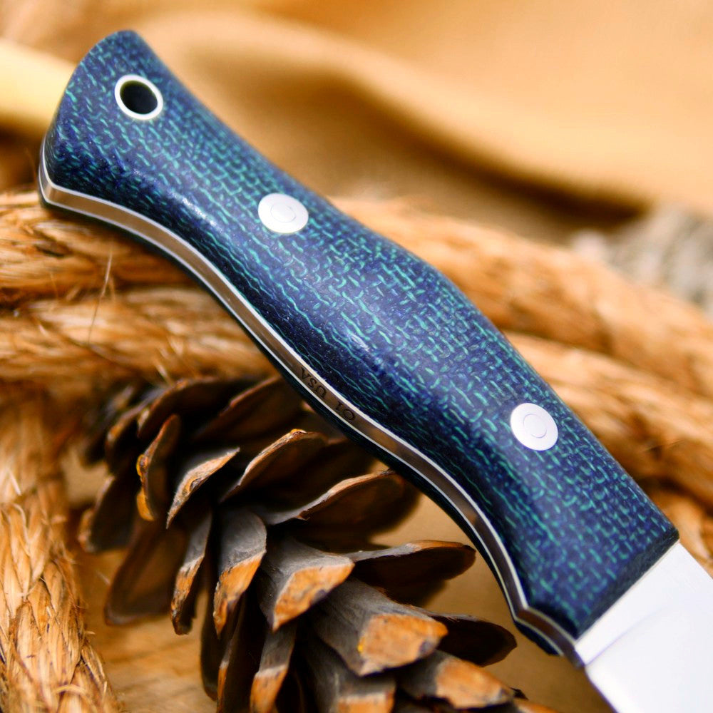 A Guide bushcraft knife with navy blue burlap handle scales