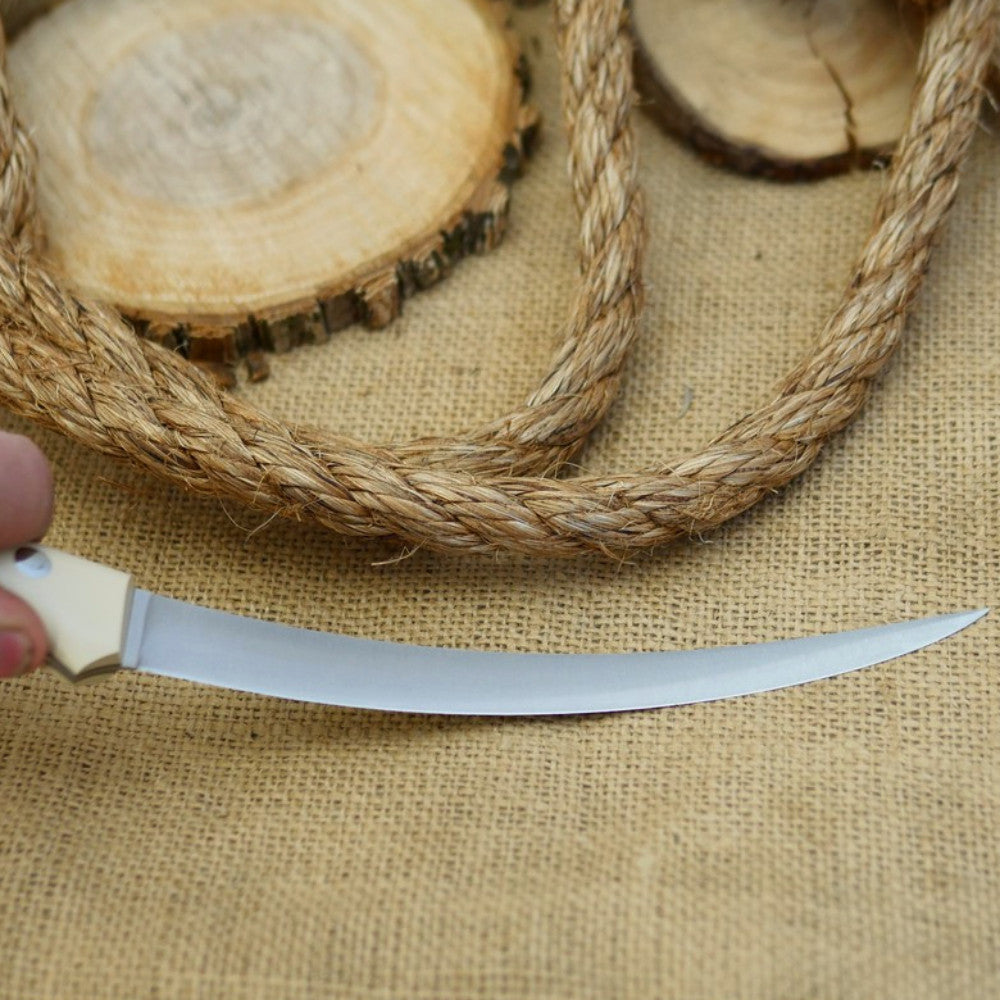 A fisherman bushcraft knife with navy blue burlap handle material and ivory paper bolster