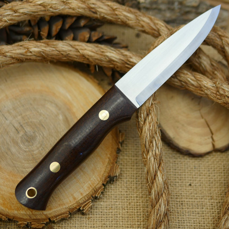 An Adventure Sworn classic bushcraft knife with dark brown burlap micarta handle scales and thick maroon canvas liners.