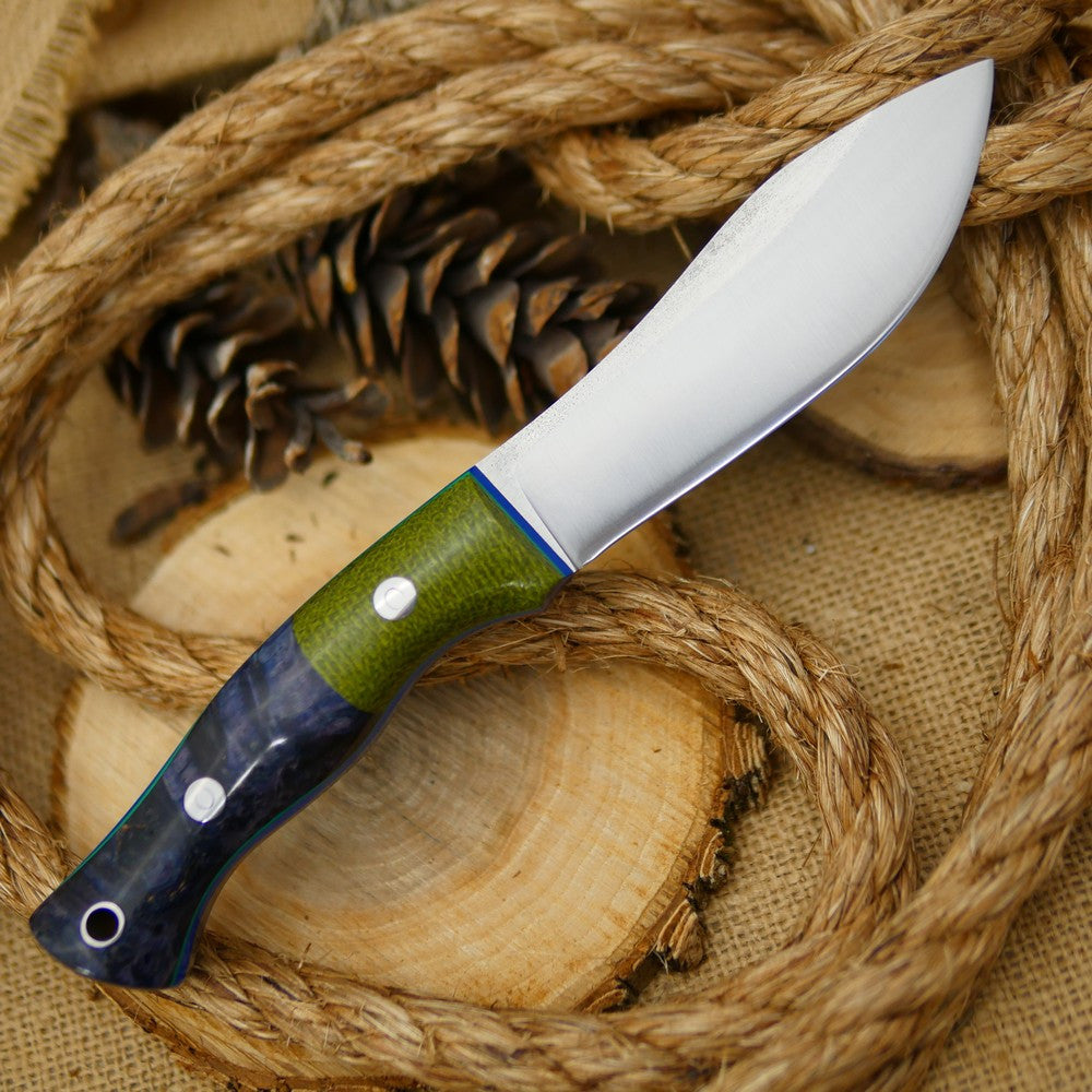 Adventure Sworn Guide bushcraft knife with blue box elder handle scales and emerald green burlap bolster.