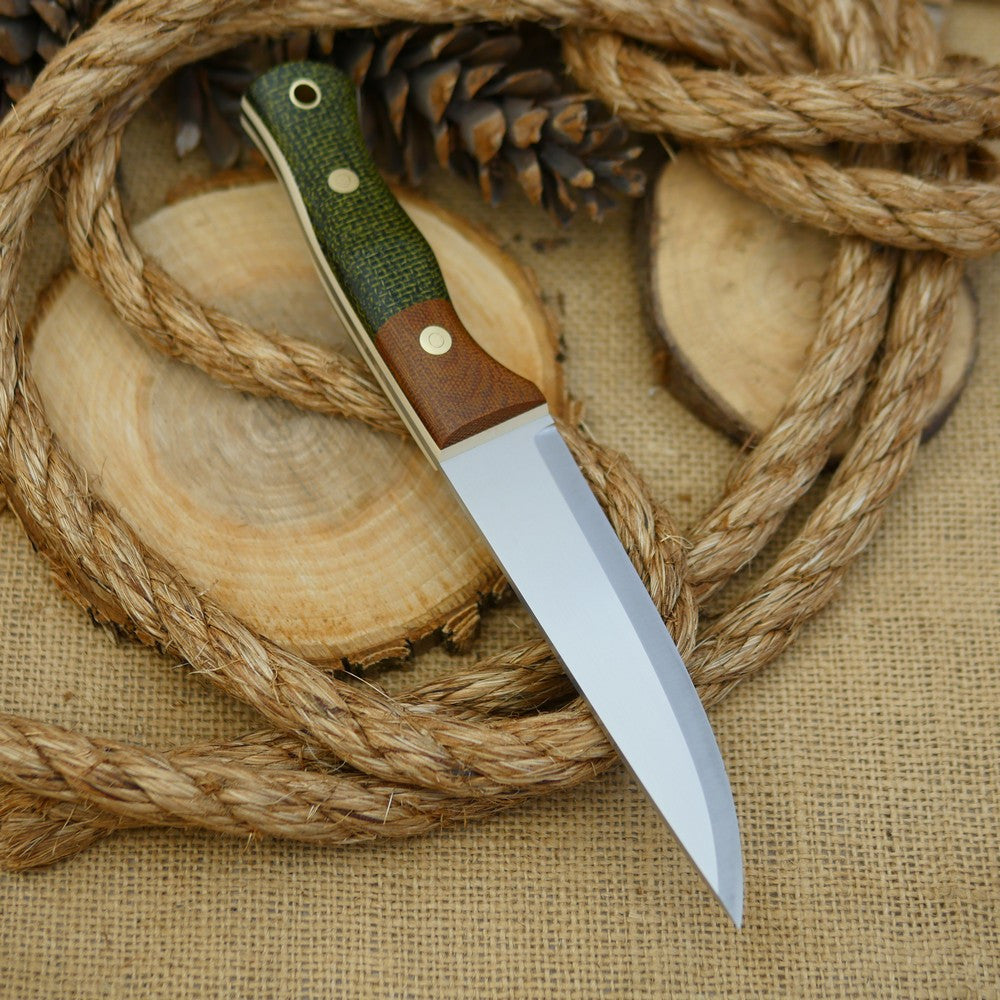 An Adventure Sworn bushcraft knife with evergreen burlap handle scales and natural brown canvas micarta bolster.