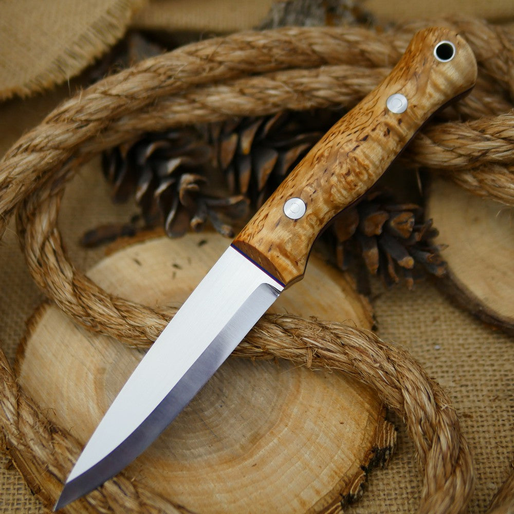 An Adventure Sworn Mountaineer bushcraft knife with karelian birch handle scales and thin blue and red liners.