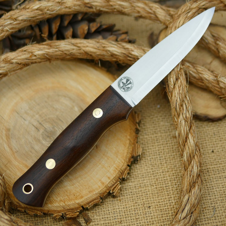 An Adventure Sworn Classic bushcraft knife with walnut handle scales and maroon canvas micarta liners