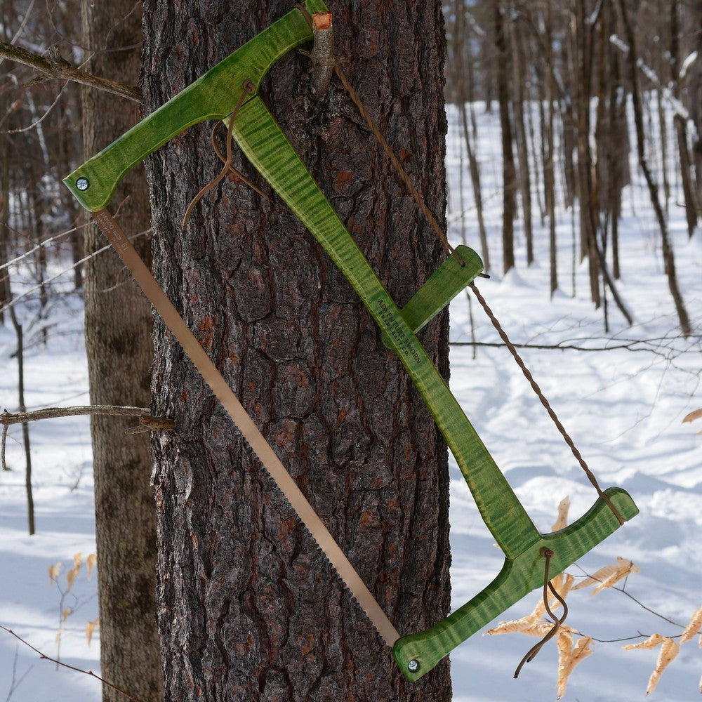 Curly maple bucksaw with spring green dye and clear coat used for bushcraft.