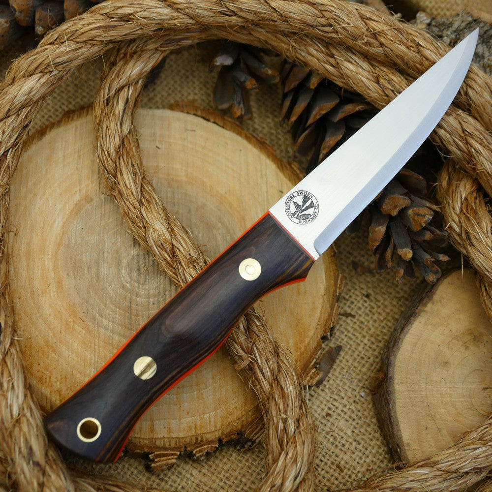 A Voyageur bushcraft knife with cocobolo handle scales and hunter orange g10 liners