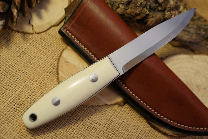 Woodsman Bushcraft Knife, white ivory paper micarta, white ivory paper micarta liners, black secondary liners