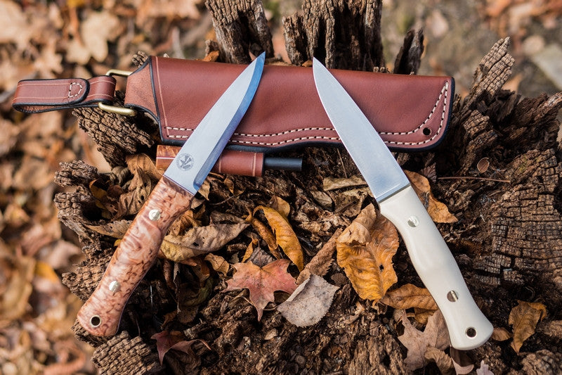 Mountaineer bushcraft knife; ivory paper (right), karelian birch (left)