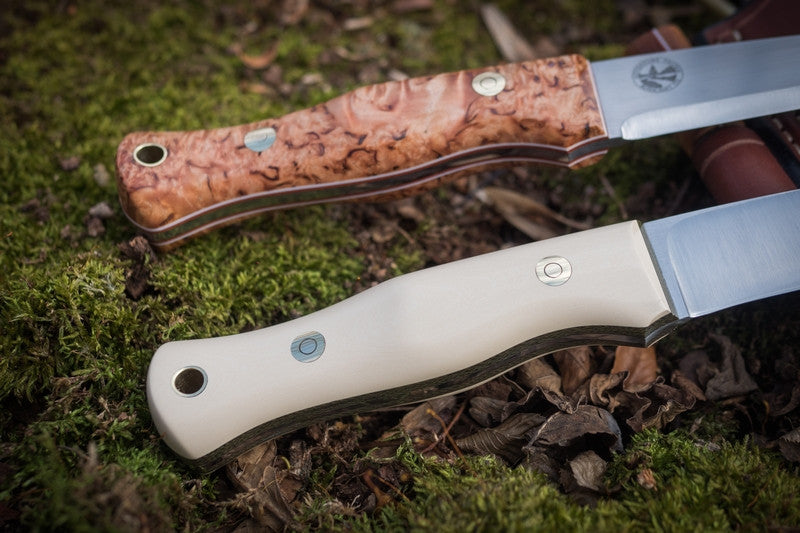 Mountaineer bushcraft knife; ivory paper (bottom), karelian birch (top)