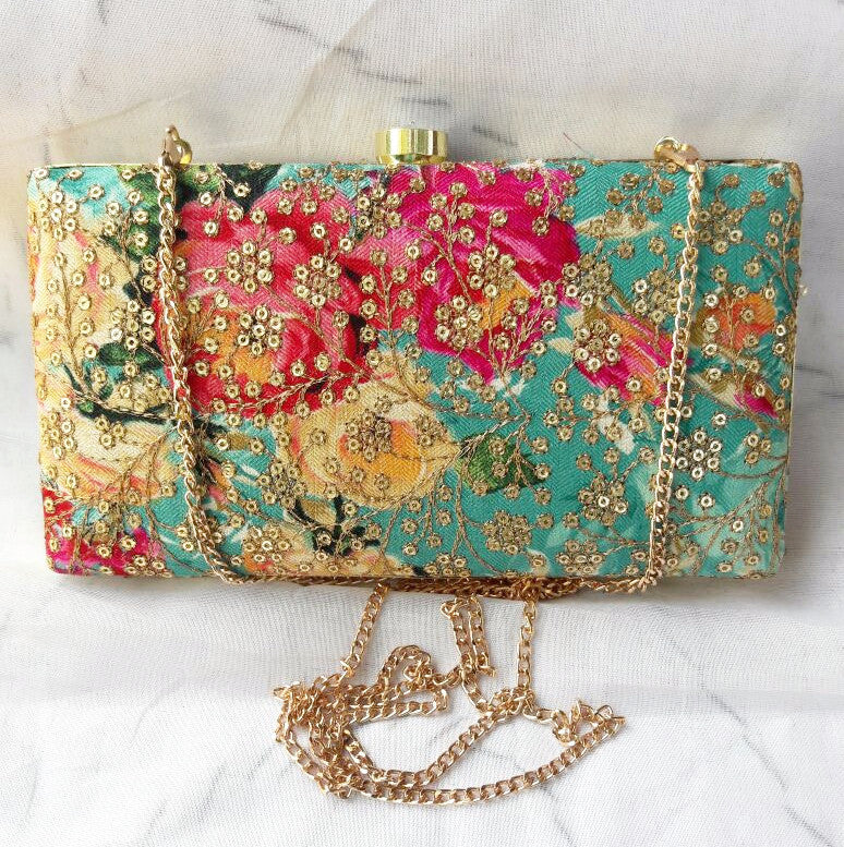 Clemonte blue sequinned zardozi clutch with vintage rose design