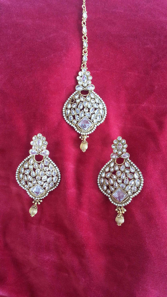 Clemonte Arya Gold kundan earrings with maang teeka