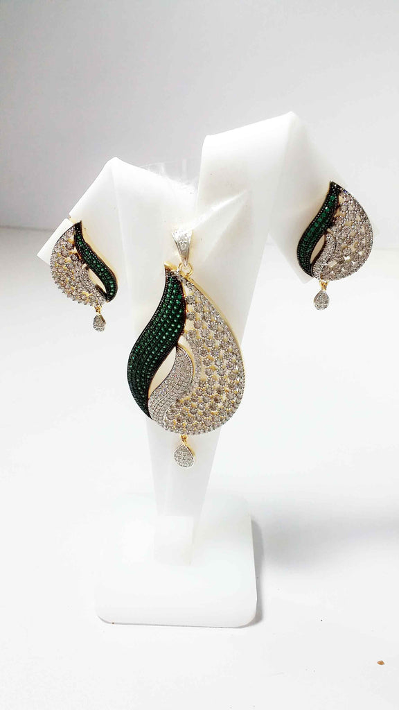 Clemonte Diamond pendant and earrings set with green stones
