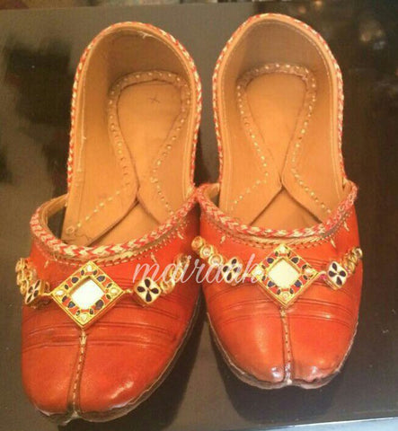 Golden orange juttis with mirror work
