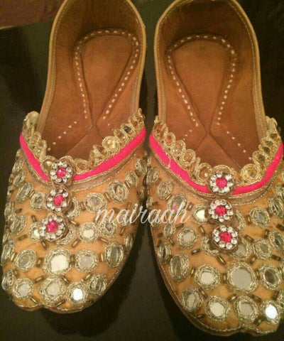 Golden beaded juttis with mirror work