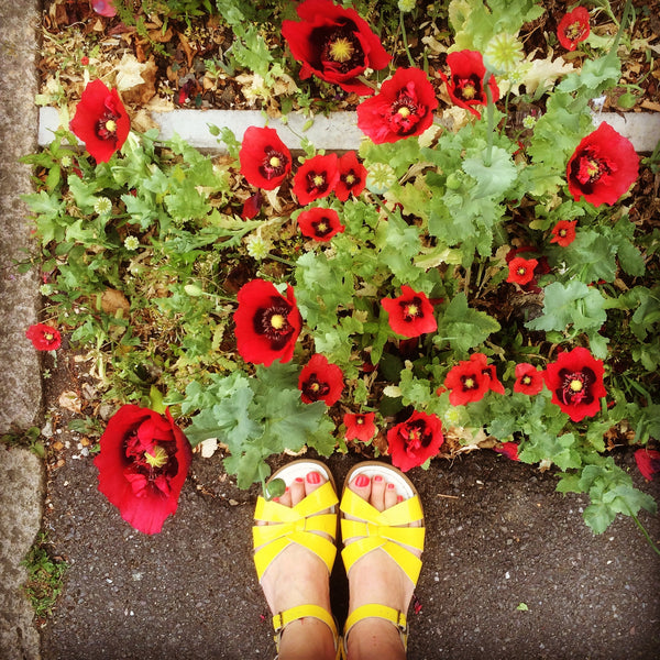 Poppies, pavement and yellow Saltwater sandals in London - Yellow Lolly Blog