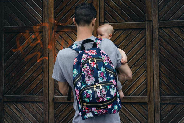 Tiba + Marl Elwood Floral Baby Change Backpack in Floral Print from Yellow Lolly