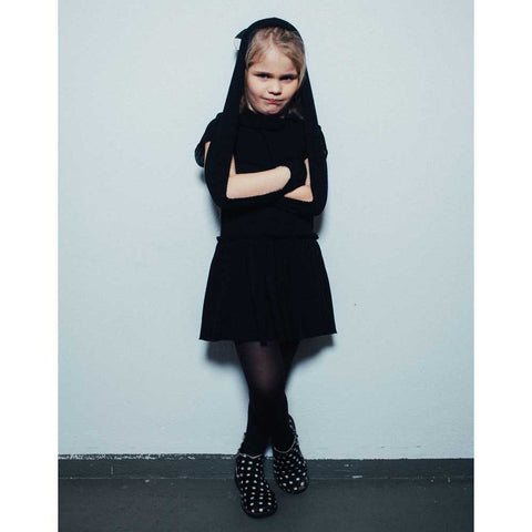 Girl Wearing Noé and Zoë Black Bubble Peterpan Dress