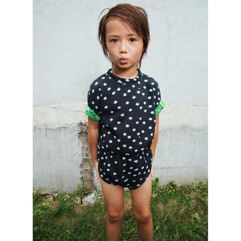 Child wearingAgatha Cub Bunny Black Shorts Romper - Yellow Lolly