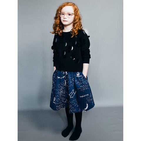 Girl Wearing Beau Loves Midnight Blue Galaxy Swing Skirt