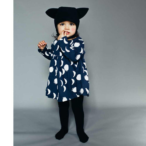 Toddler Wearing Beau Loves Moons, Midnight Blue Baby Dress