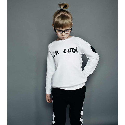 Girl Wearing Beau Loves White Uncool + O Sweatshirt