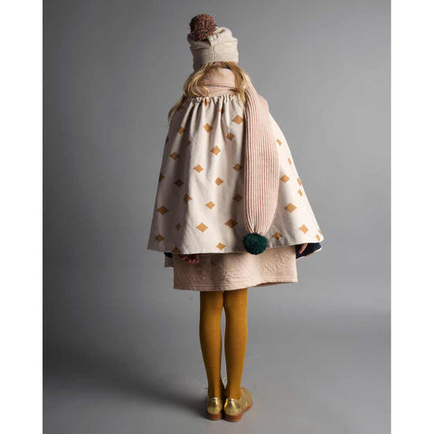 Girl wearing Bobo Choses Diamond Sky Velvet Cape - Pink side - Yellow Lolly