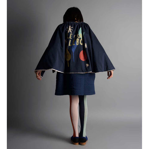 Girl wearing Bobo Choses Diamond Sky Velvet Cape - Navy side - Yellow Lolly