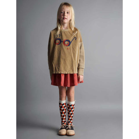 Girl wearing Bobo Choses Op Art Blue Long Socks - Yellow Lolly