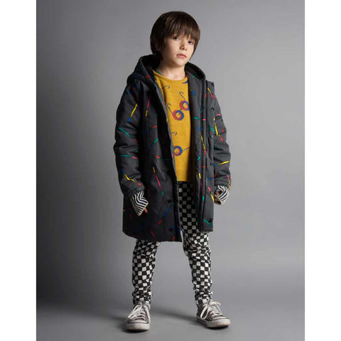 Boy wearing Bobo Choses Charcoal Grey Magic Wands Hooded Anorak - Yellow Lolly