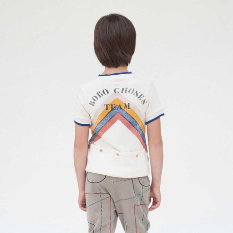 Back of child wearing Bobo Choses White Gino Track Top - Yellow Lolly