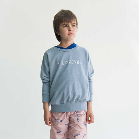 Child wearing Bobo Choses Blue B.C. Team Sweatshirt (front) - Yellow Lolly