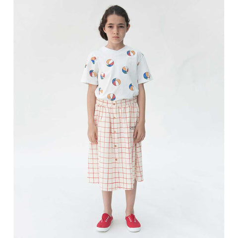 Girl wearing Bobo Choses Cream Nets Buttoned Midi Skirt (front) - Yellow Lolly