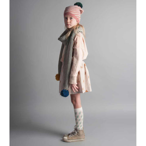 Girl wearing Bobo Choses Pink Hipnotized Pom Pom Beanie - Yellow Lolly