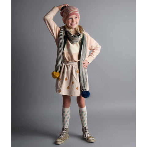 Girl wearing Bobo Choses Diamond Sky Velvet Skirt - Yellow Lolly