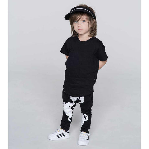Boy Wearing HuxBaby Black Big Falling Bears Drop Crotch Pants