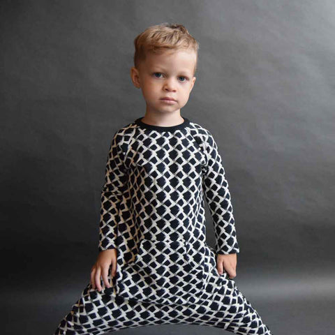 Boy wearing Jax & Hedley Washed Black Mountain Onesie - Yellow Lolly