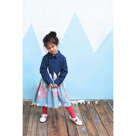 Girl wearing Milk & Biscuits Sadie Shirtdress with mountain print from Yellow Lolly