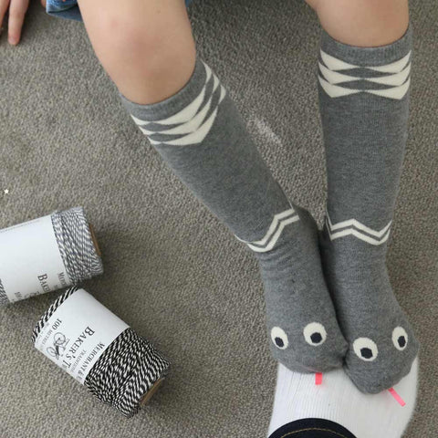 Child wearing Mini Dressing Grey Snake Knee Socks from Yellow Lolly