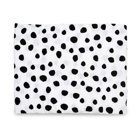 Modern Burlap Baby Swaddle in white organic cotton with irregular black spots.