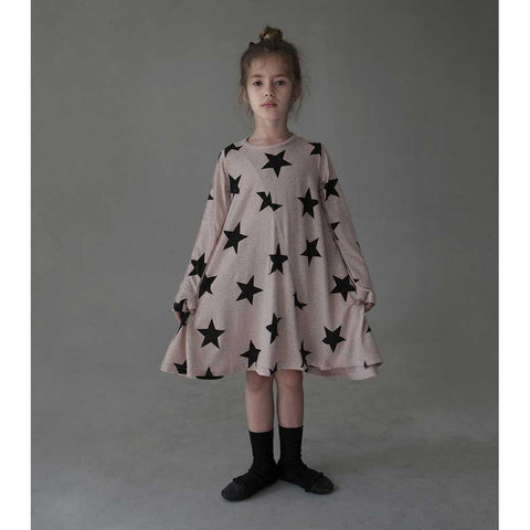 Girl Wearing Nununu 360 Powder Pink Star Dress