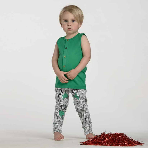Girl Wearing Papu Cucumber Green Kids Vest Top at Yellow Lolly