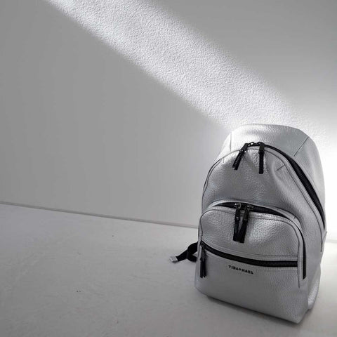 Tiba + Marl - Silver Elwood Baby Backpack on floor - Yellow Lolly