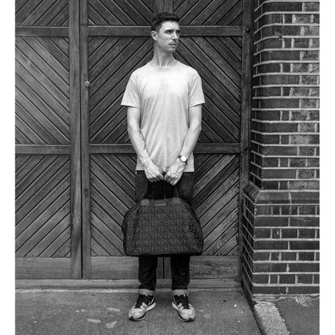 Man carrying Tiba + Marl Raf Black Holdall from Yellow Lolly