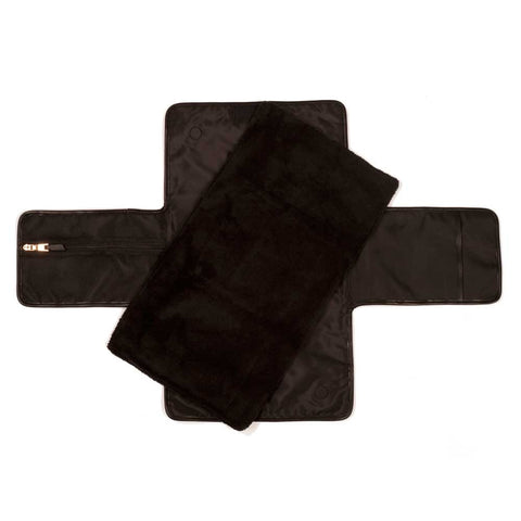 Tiba + Marl Etta Black Baby Changing Clutch shown with mat