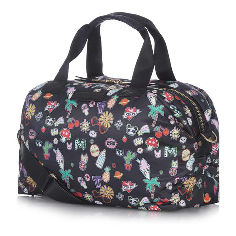Side view of Tiba + Marl Sticker Print Mini Raf Holdall Baby Change Bag - Yellow Lolly