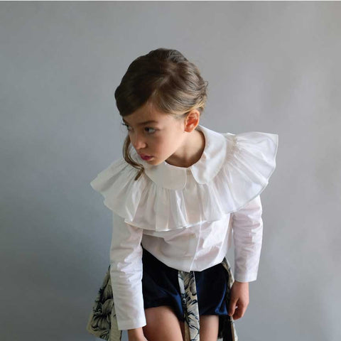 Girl wearing Wolf & Rita Alzira White Frilled Blouse - Yellow Lolly