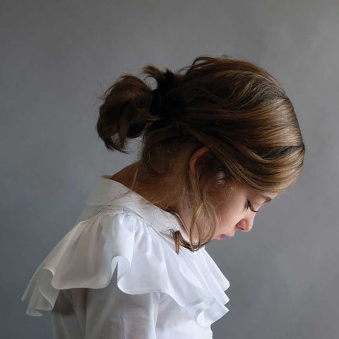 Girl wearing Wolf & Rita Alzira frilled White Blouse - Yellow Lolly