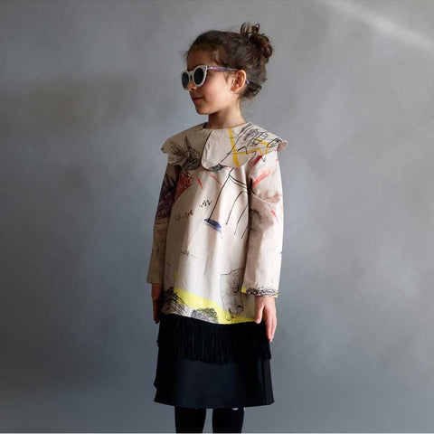 Girl wearing Wolf & Rita Palmira Faces Print Dress - Yellow Lolly