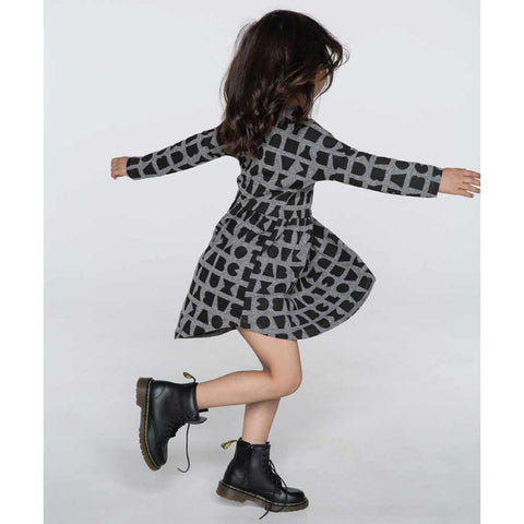Girl Wearing HuxBaby Grey Black Alphabet Swirl Dress