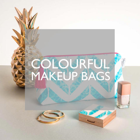 Colourful Tasselled Makeup Bags by Penelope Hope