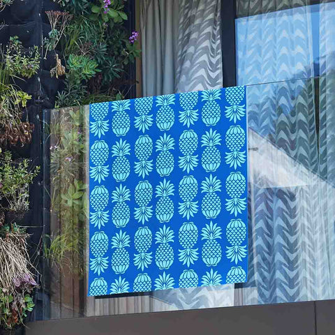 Outdoor Fabric Pineapple Blue Mix Draped over a Balcony by Penelope Hope